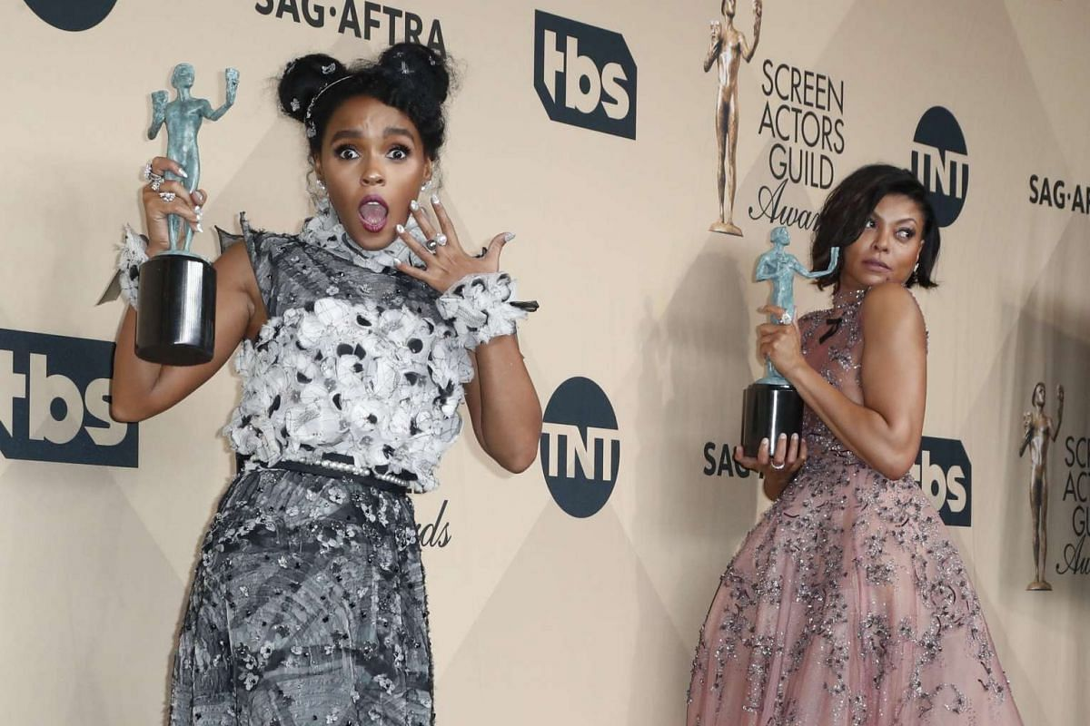 Janelle Monae (left) and Taraji P. Henson pose with their SAG Award for Outstanding Cast in a Motion Picture award for Hidden Figures at the Shrine in Los Angeles, California, on Jan 29, 2017.