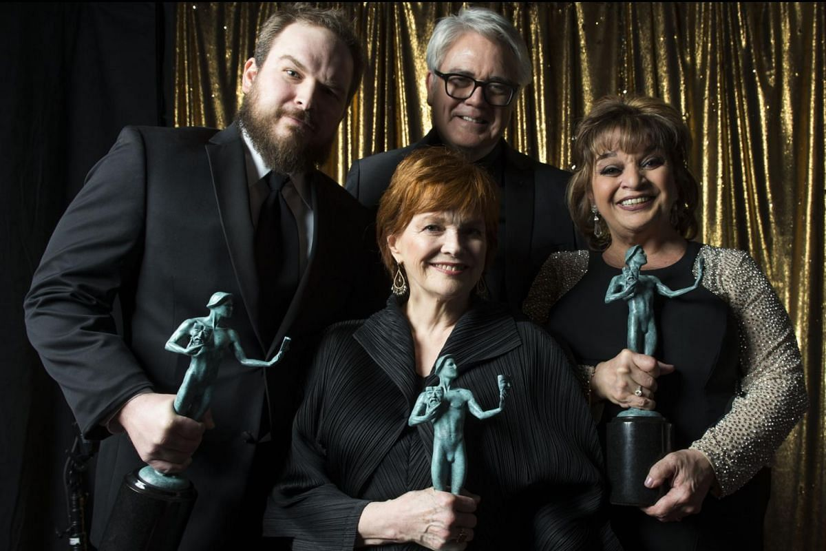 (From left) Matt Peters, Blaire Brown, Michael Harney and Lin Tucci from Orange Is The New Black pose with their award for Outstanding Performance by an Ensemble in a Comedy Series at the 23rd Annual SAG Awards in Los Angeles, California, on Jan 29,