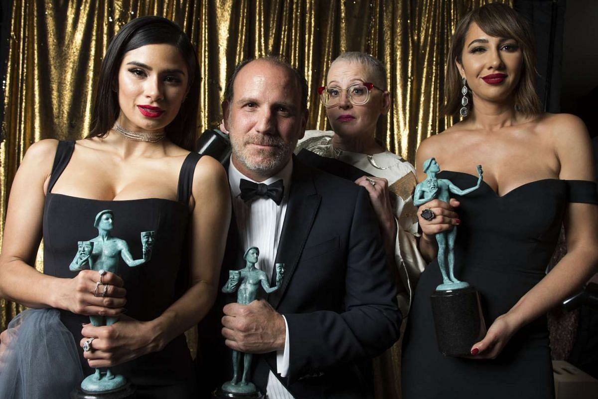 (From left) Diane Guerrero, Nick Sandow, Lori Petty and Jackie Cruz from Orange Is The New Black pose with their award for Outstanding Performance by an Ensemble in a Comedy Series at the 23rd Annual SAG Awards in Los Angeles, California, on Jan 29,