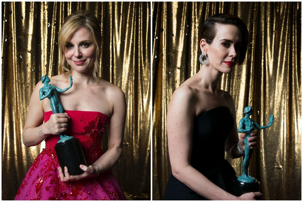 Actresses Cara Buono (left) of Stranger Things and Sarah Paulson of The People V. O.J. Simpson: American Crime Story pose with their awards for Outstanding Performance by an Ensemble in a Drama Series and Outstanding Performance by a Female Actor in