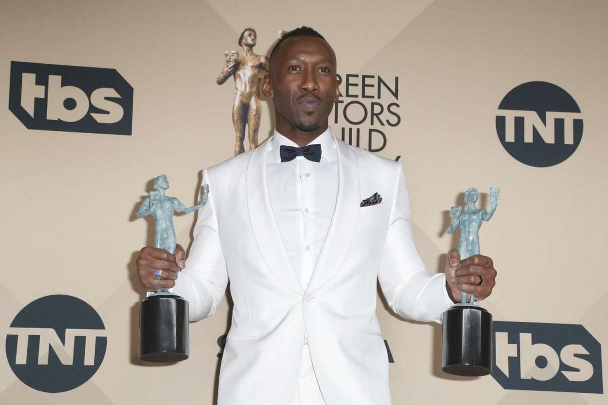 Mahershala Ali poses with his two SAG Awards for Outstanding Performance by a Male Actor in a Supporting Role award for Moonlight and Outstanding Performance by a Cast in a Motion Picture award for Hidden Figures.