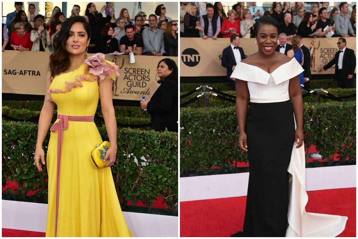 Actresses Salma Hayek and Uzo Aduba arrive for the 23rd Annual Screen Actors Guild Awards at the Shrine Exposition Center on Jan 29, 2017, in Los Angeles, California.