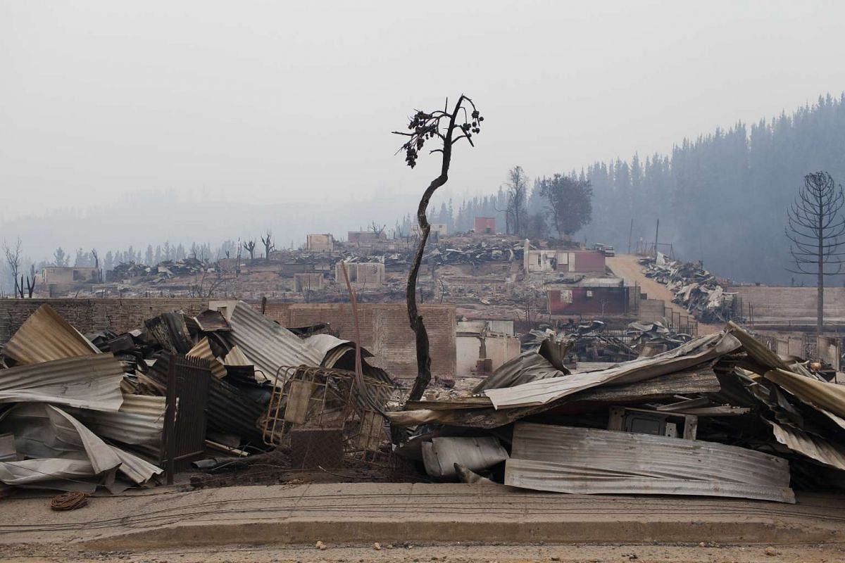 The wreckage of homes destroyed by wildfires is seen in the town of Santa Olga in Constitucion, Chile, on Jan 27, 2017.