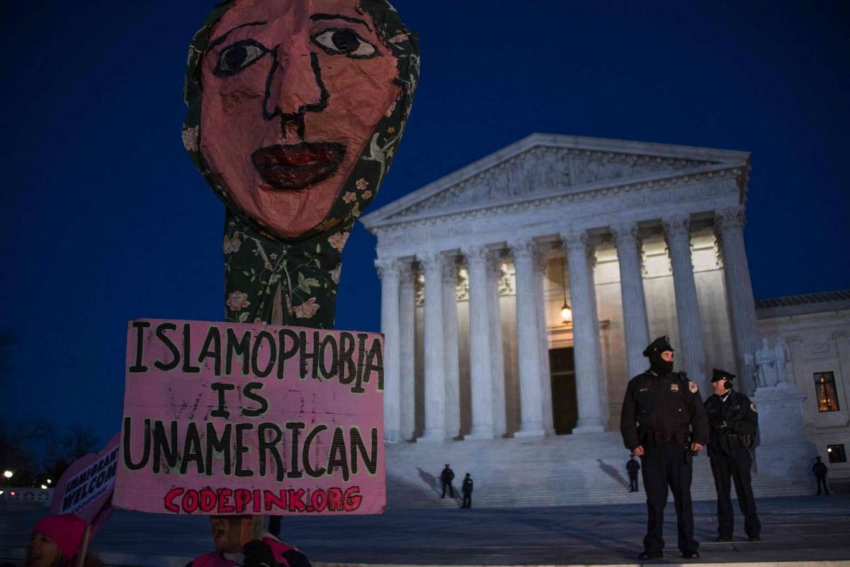 Demonstrators gather outside the US Supreme Court demanding US President Donald Trump reverse anti-refugee and anti-immigration executive orders in Washington, DC on Jan 30, 2017.