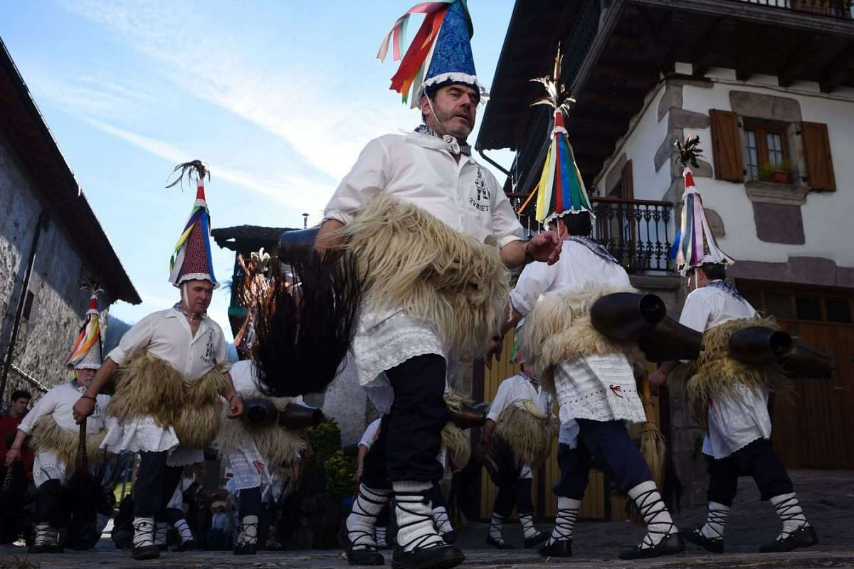 """Bellringers, known as """"Joaldunak"""" in Basque language march with big cowbells tied to their backs during the ancient carnival of Zubieta, in the northern Spanish Navarra province on Jan 31, 2017."""
