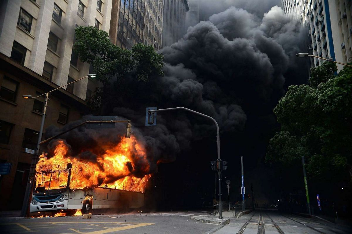 A bus burning after being set on fire during a protest by government workers in Rio de Janeiro, Brazil, on Feb 1, 2017.