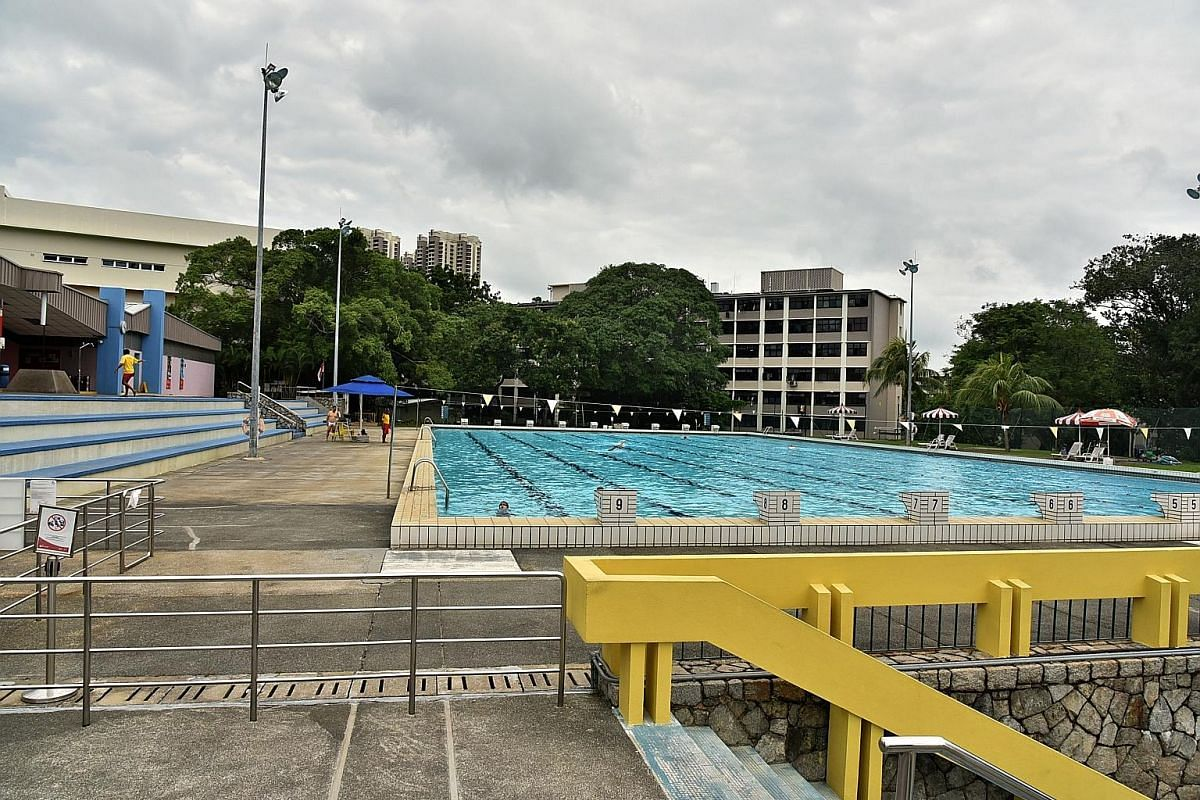The Katong Swimming Complex (left), built in 1975, continues to lap up attention from swimmers. It has escaped the fate of the Yan Kit pool (bottom), which has been turfed over. The Queenstown Swimming Complex, built in 1970, makes waves as the train