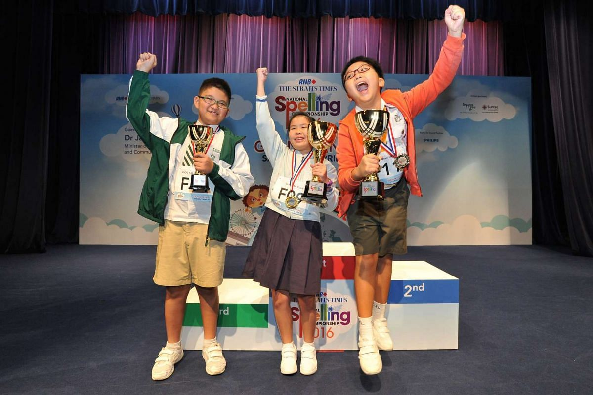 Winners of the RHB-Straits Times National Spelling Championship 2016: (from left) Aloysius Khoo, 12, from St Joseph's Institution Junior was third; Sophi Tan from Raffles Girls' Primary School was the champion; and Ho Wing Yip, 11, from Catholic