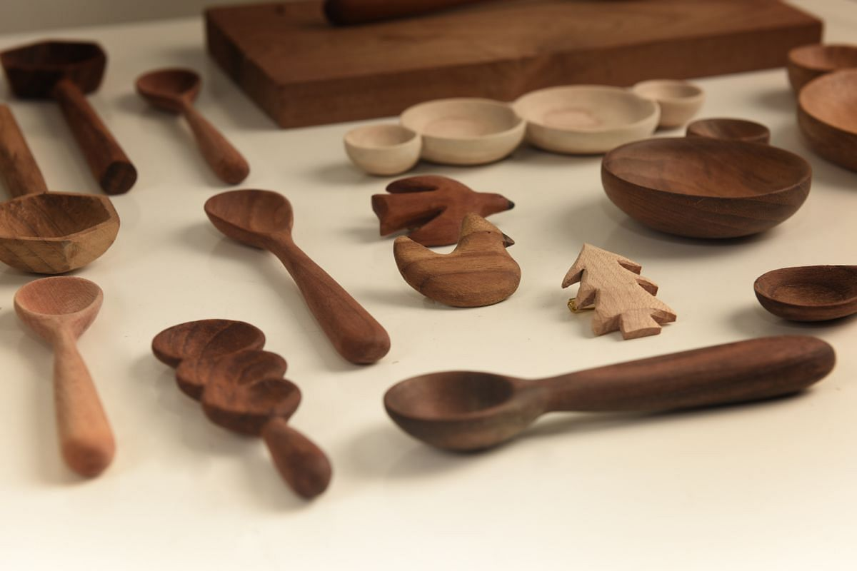 Everyday Canoe founder Ng Xin Nie and her range of custom-made spoons and brooches (above).