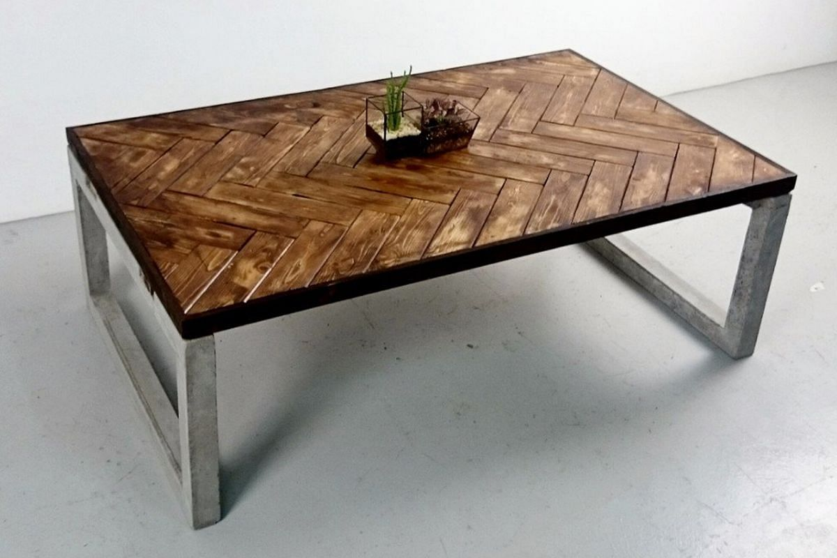 Triple Eyelid's Jackie Tan makes the company's furniture pieces, including the Herringbone Coffee Table (above) and the Blacksmith Night Stand.