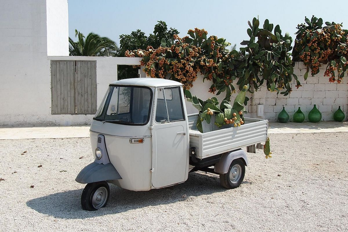 The Piaggio Ape, a lightweight, three-wheel truck that is to the Italian countryside what the Vespa is to its cities. Fresh fruit and herbs for sale at a corner store in Gallipoli. In the summer, the winding streets of Alberobello are filled with tou