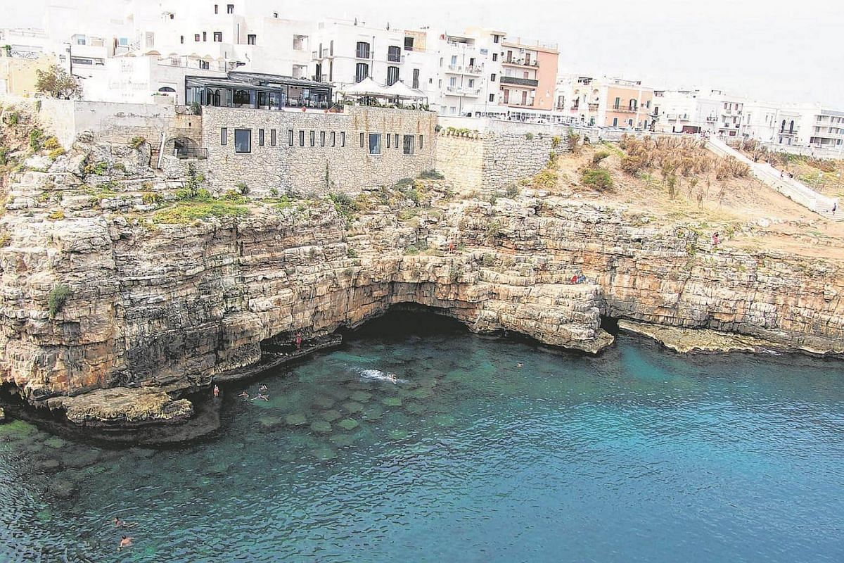 The seaside city of Polignano a Mare, is built atop towering limestone cliffs roughly 30km from Bari, Puglia's capital.