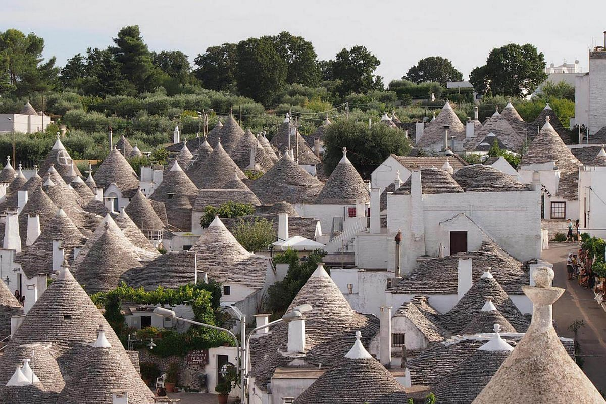 The trulli houses, traditionally made of loose stones with conical roofs, are thought to have originated centuries ago as a way for people living in the country to evade land tax.