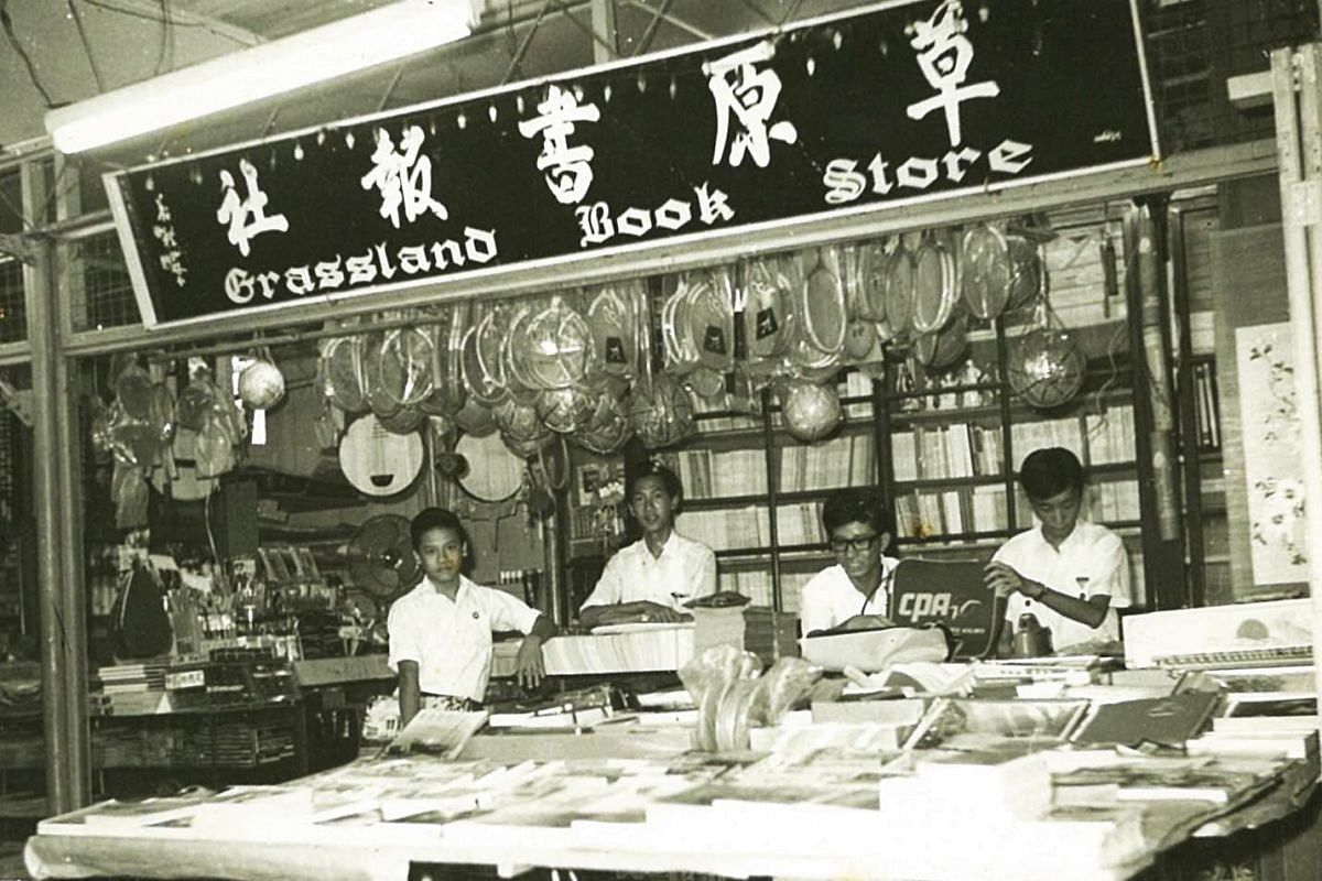 Grassland Book Store started as a makeshift stall at the carpark of Beauty World in 1966. Its founder, Mr Chew Ching Suaa (second from far left) is 18 years old in the photo.