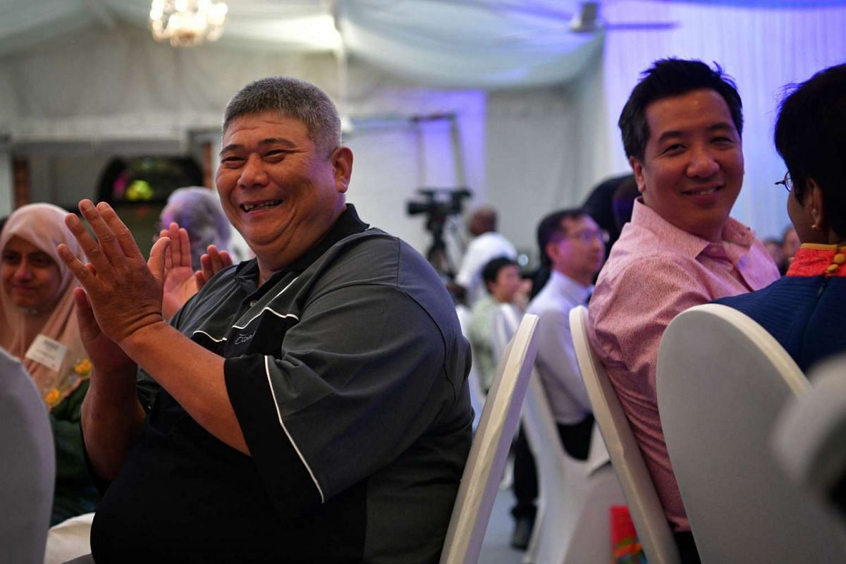 Finalist John Shu claps after a short clip of him is played on screen during The Straits Times Singaporean of the Year 2016 award ceremony.