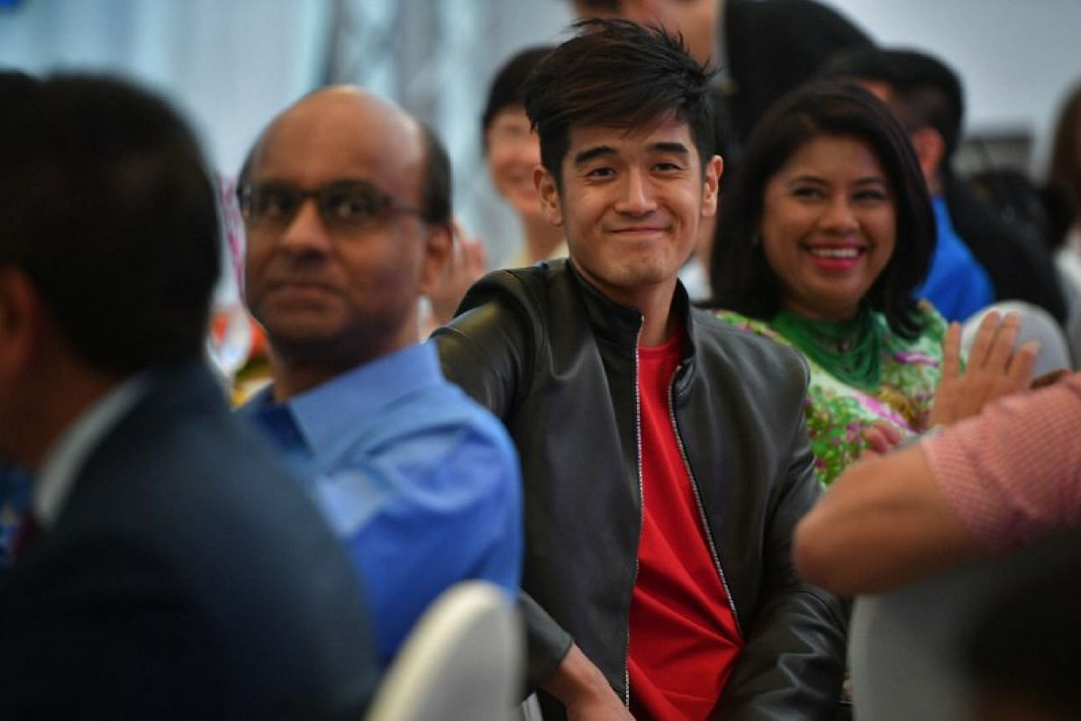 Nathan Hartono (centre), and Deputy Prime Minister Tharman Shanmugaratnam (left) pictured during The Straits Times Singaporean of the Year 2016 award ceremony held at UBS Business University Asia Pacific, formerly the Command House, on Feb 6.
