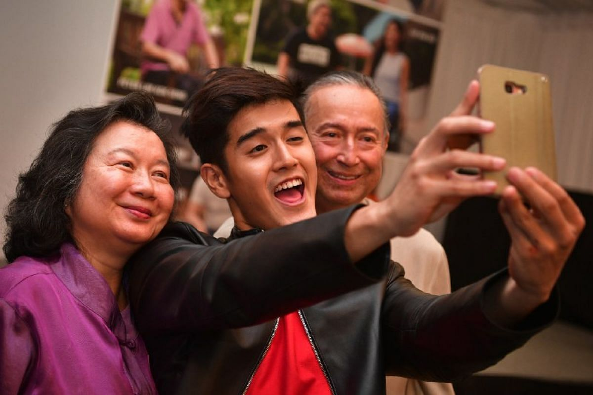 Winners Colin and May Schooling, take a wefie with fellow finalist Nathan Hartono.