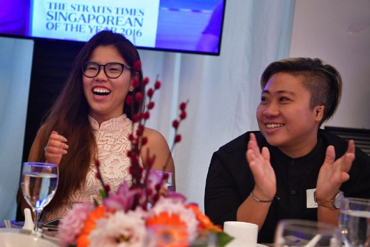 Paralympians Yip Pin Xiu and Theresa Goh react as a short clip of them is played during The Straits Times Singaporean of the Year 2016 award ceremony.