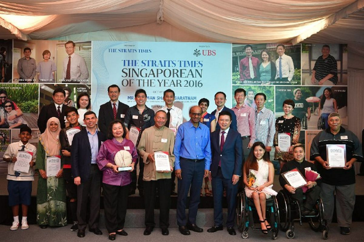 Deputy Prime Minister Tharman Shanmugaratnam (centre), Mr Warren Fernandez, ST editor and editor-in-chief of Singapore Press Holdings' English, Malay and Tamil Media Group (fourth from left) and Country Head, UBS Singapore and Head Wealth Management,