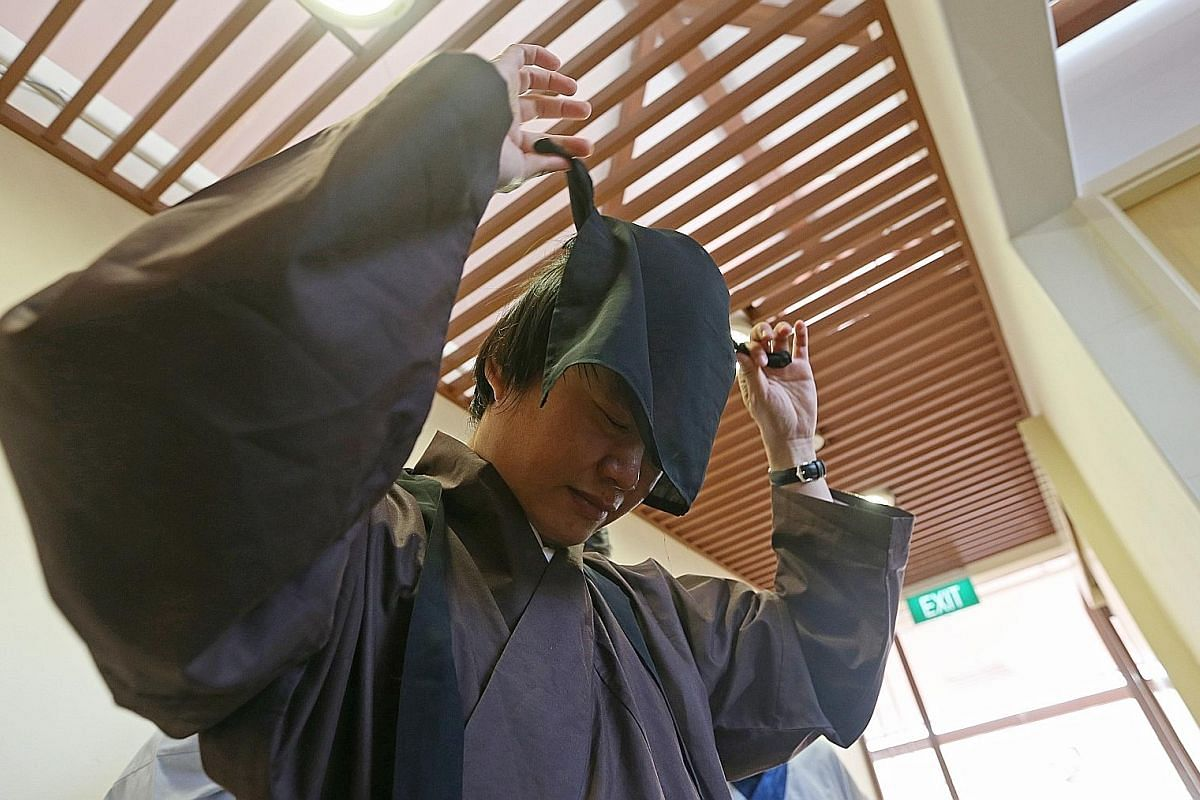 """Ms Gonggoing to work in a Tang Dynasty-style Hanfu. Unlike her colleagues who dress down on Fridays, she dresses up. """"My colleagues will come to my cubicle to see what I am wearing. They say that the walkway to my cubicle is my runway on Fridays,"""" sh"""