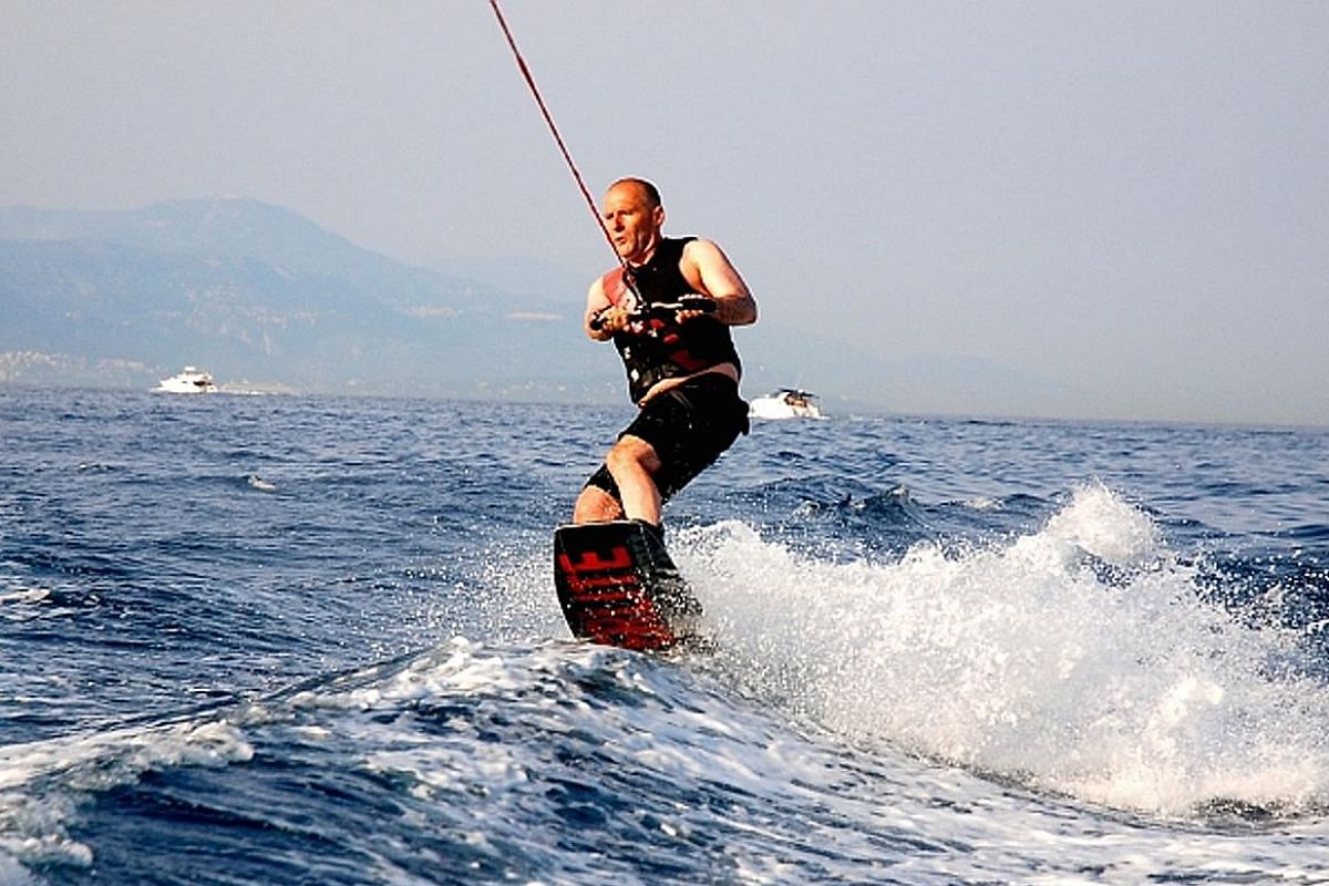 My life so far: The chief executive wakeboarding on Lake Geneva (above), also in 2016.