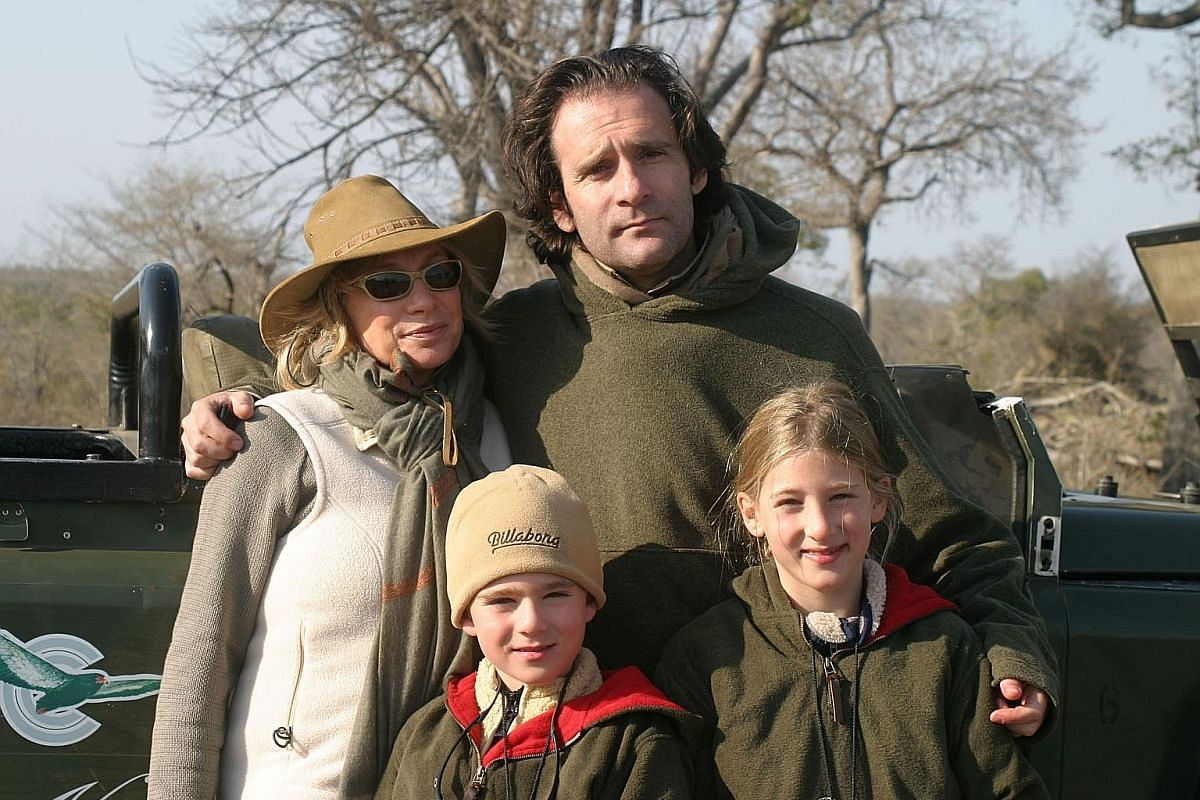 My life so far: Mr Tollman with his wife, Toni, and his children, Jack and Deia, in South Africa in 2002.