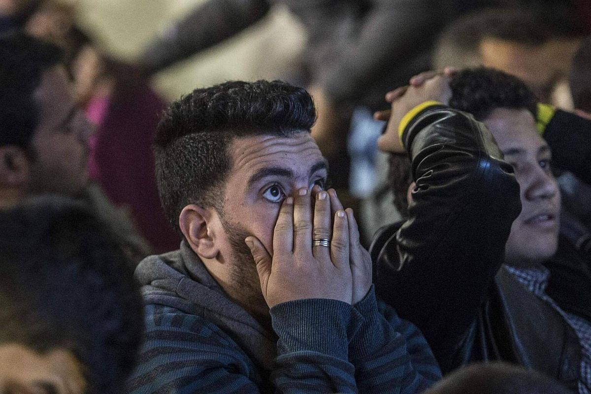 Egyptian fans watching the Africa Cup of Nations football match between Egypt and Cameroon on screen on Feb 5, 2017.