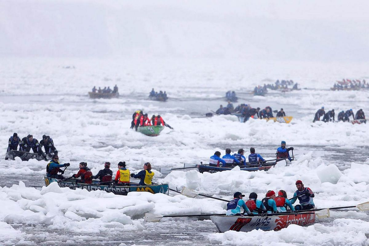 Canoers competing in the Ice Canoe race at the Quebec Winter Carnival in Quebec City on Feb 5, 2017.