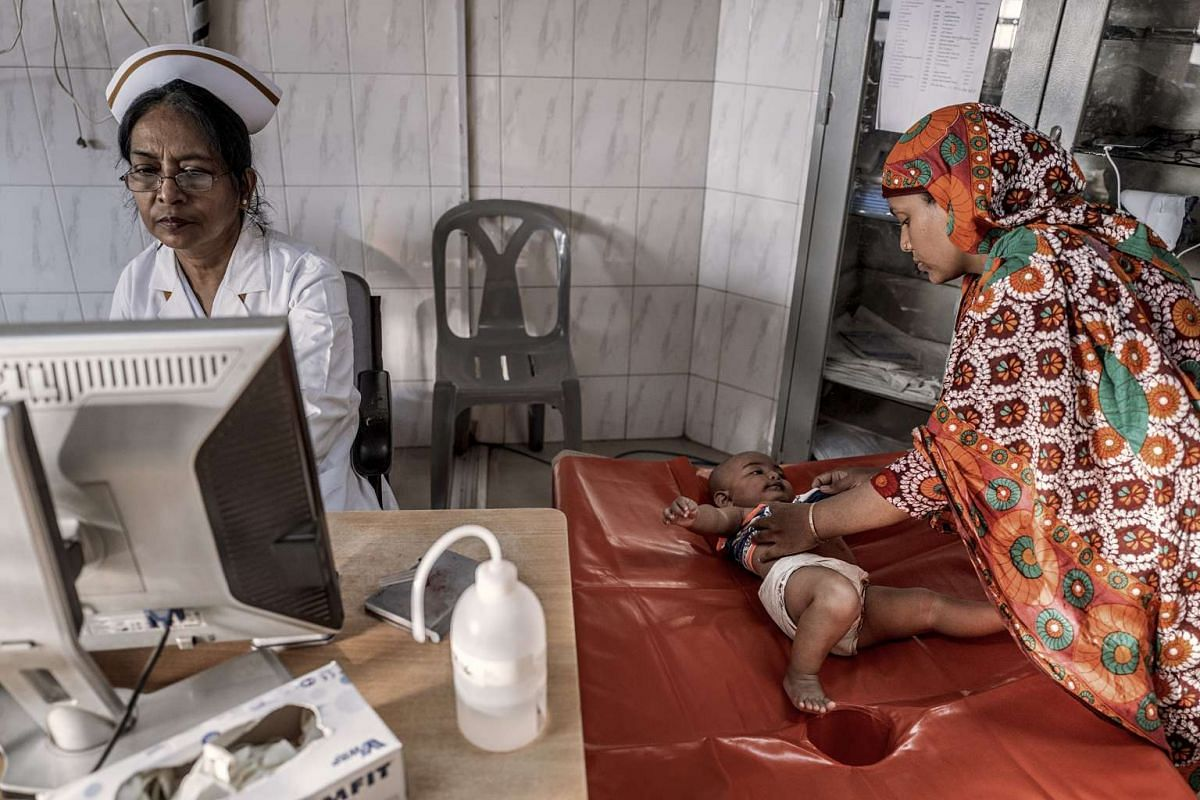 A nurse does a general screening of an infant with cholera at the International Centre for Diarrheal Disease Research in Dhaka, Bangladesh, on Aug 14, 2016.