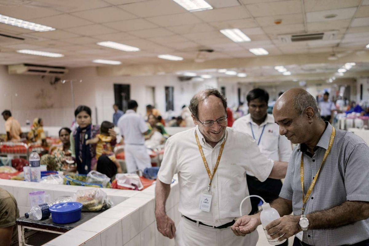 Dr. John Clemens (left) on the hospital floor in Dhaka, Bangladesh, on Aug 17, 2016.