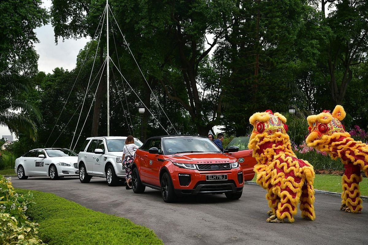 The finalists receiving a grand welcome at the awards ceremony yesterday. They were ferried by a fleet of 10 Land Rovers and two Jaguars, and greeted with a lion dance performance. Paralympians Yip Pin Xiu (left) and Theresa Goh with Dr Chi Wei Ming