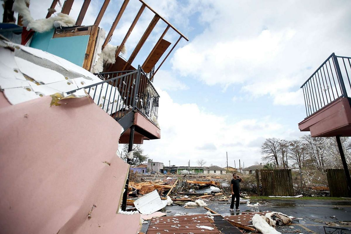 A man walks through the debris of a motel on Chef Menture Ave after a tornado in New Orleans, Louisiana, on Feb 7, 2017.