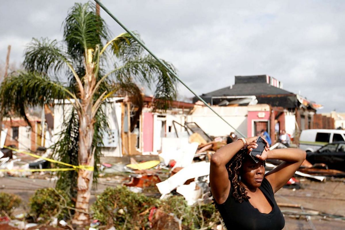 A woman looks at the wreckage caused by a tornado in New Orleans, Louisiana, on Feb 7, 2017.