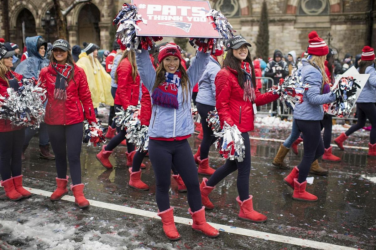 New England Patriots cheerleaders walk down Boylston Street during the Patriots victory parade on Feb 7, 2017, in Boston, Massachusetts.