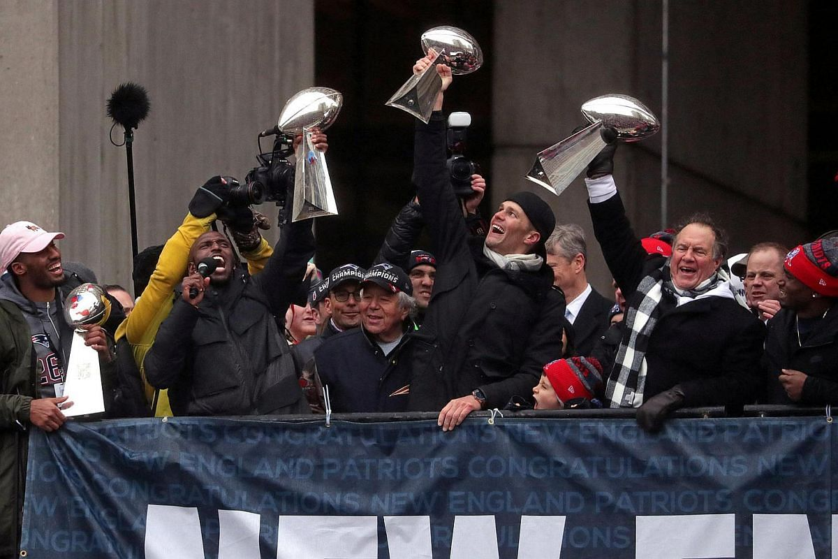 New England Patriots quarterback Tom Brady, head coach Bill Belichick and free safety Devin McCourty, hoist the Lombardi Championship trophies during Super Bowl LI victory parade in Boston, Massachusetts, US, on Feb 7, 2017.