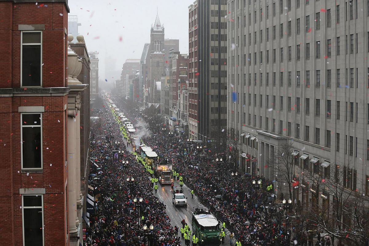 Duck boats carrying the New England Patriots make their way down Boylston Street during the New England Patriots victory parade through the streets of Boston, Massachusetts, US, on Feb 7, 2017.
