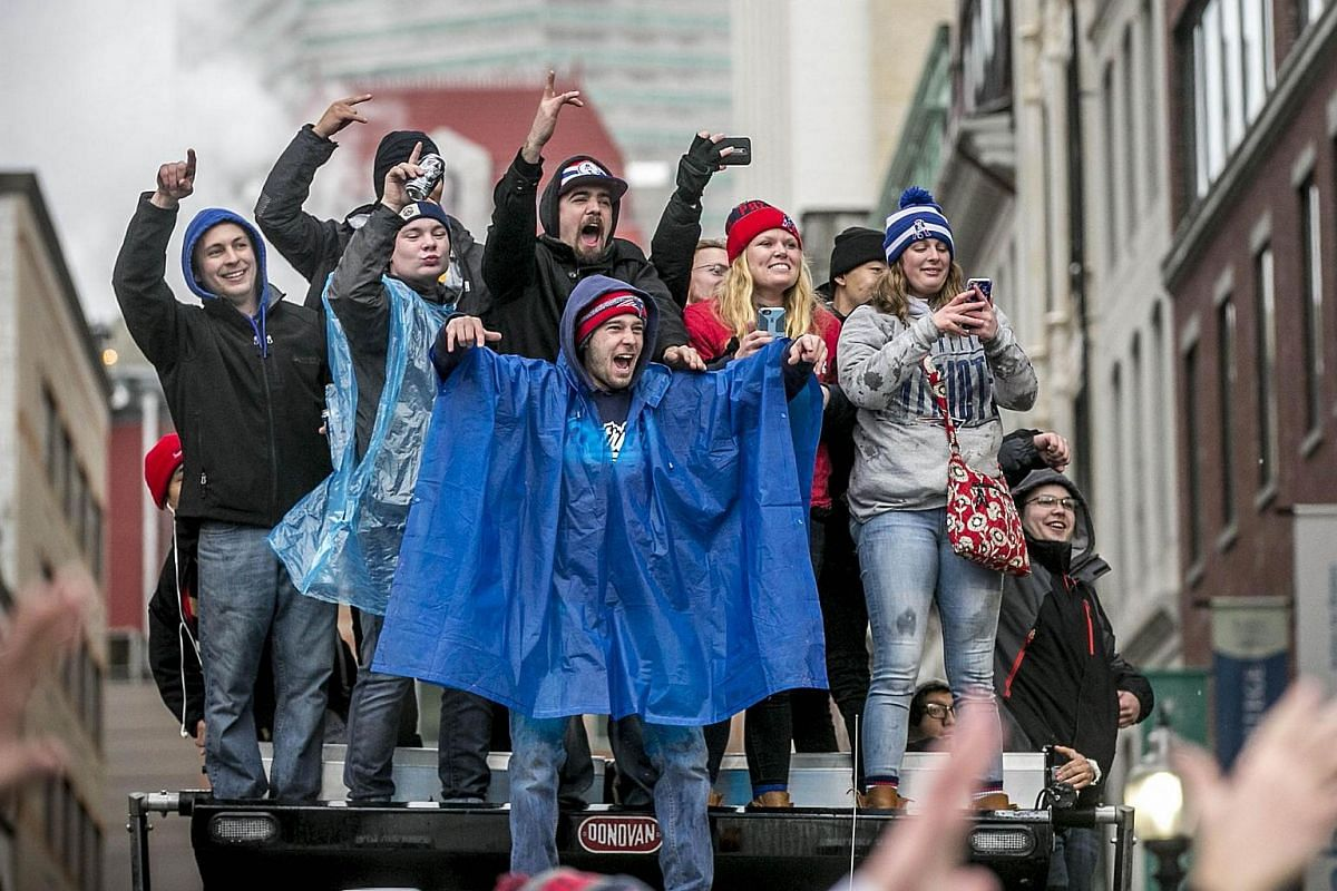 Fans watch the New England Patriots Super Bowl victory parade on Feb 7, 2017, in Boston, Massachusetts.