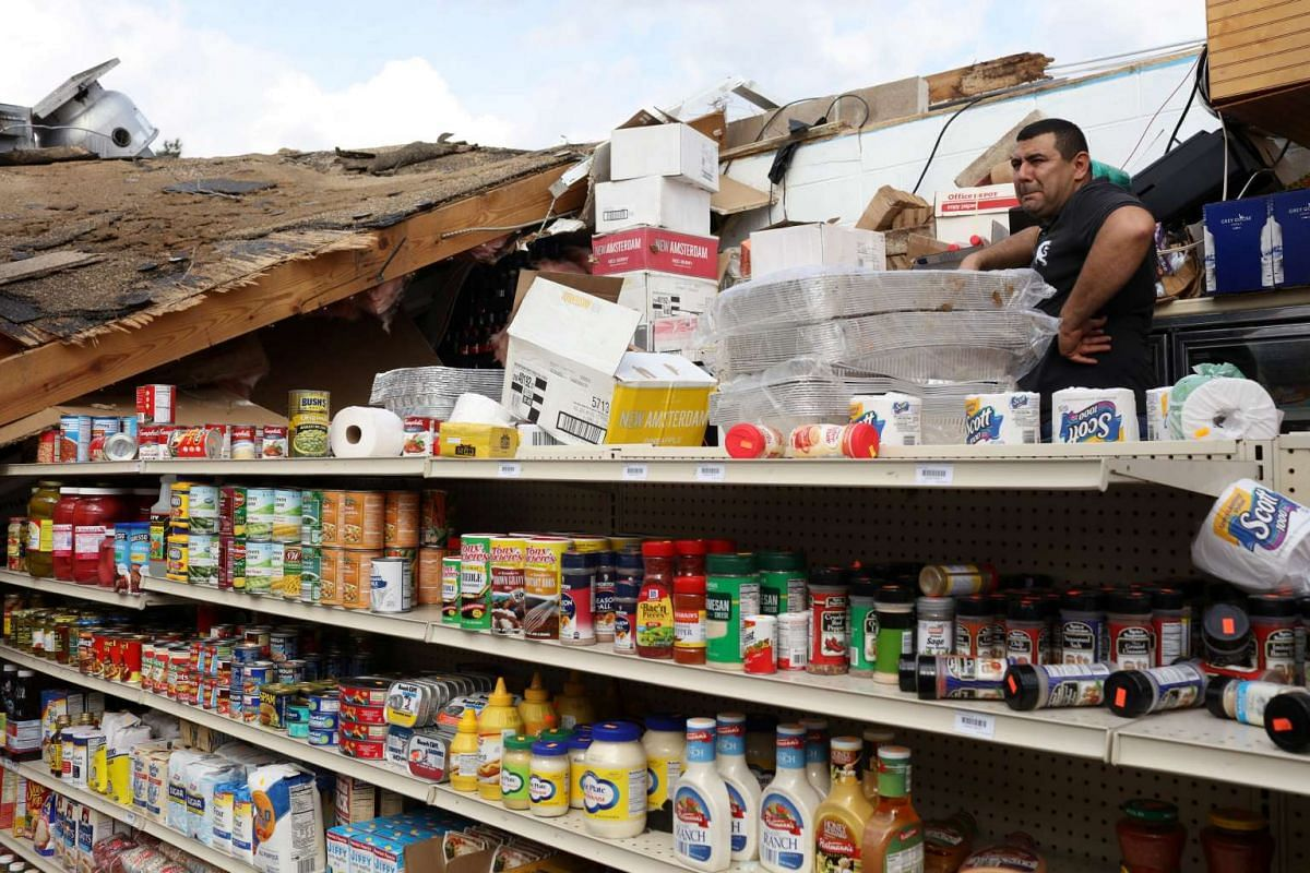 Abdel Salah, the owner of Sam's Food and Liquor Store surveys damage after a series of tornados tore through in New Orleans, Louisiana, on Feb 8, 2017.