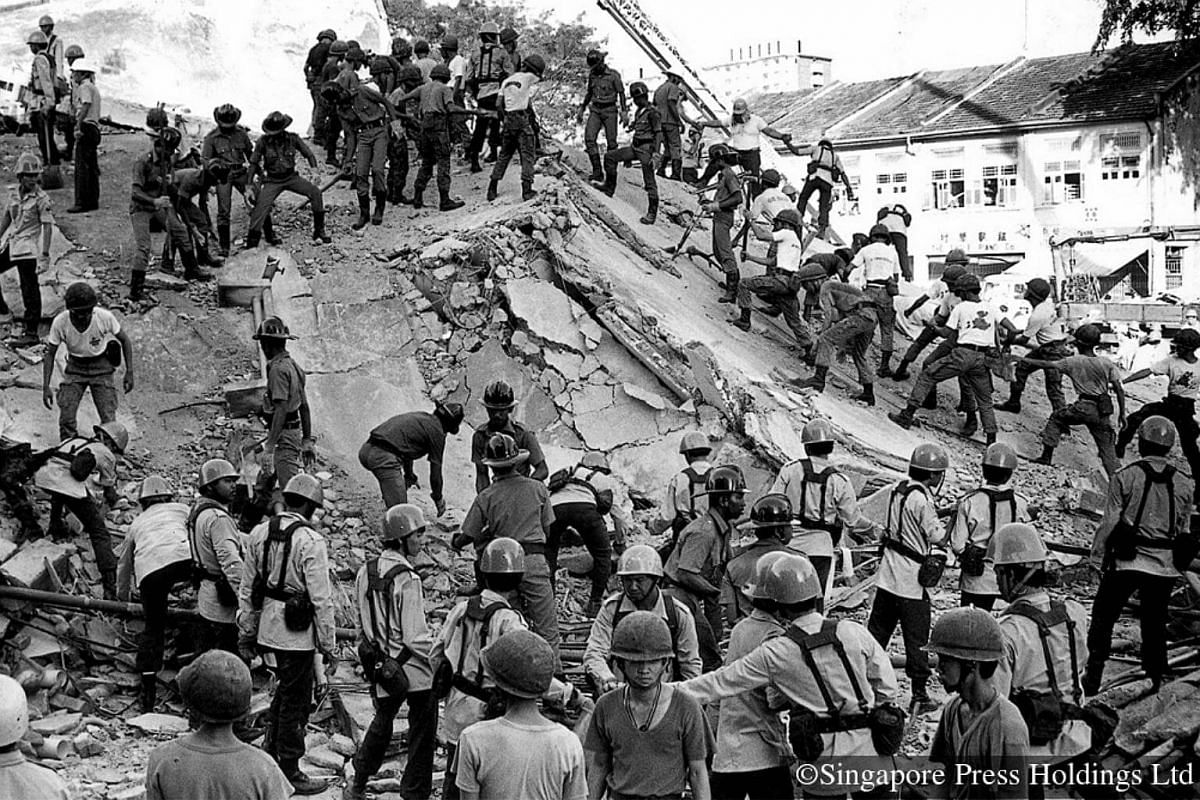 1986: Helping out at one of the worst tragedies in post-war Singapore are men from the Singapore Civil Defence Force, Fire Service and Singapore Armed Forces. The massive rescue operation at the site of the collapsed New World Hotel at Serangoon Road