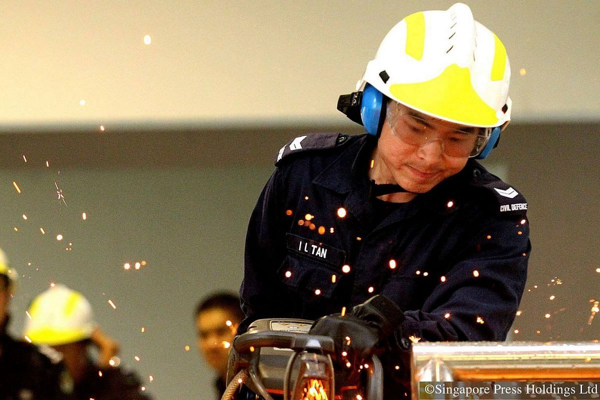 2012: NSmen from the Singapore Civil Defence Force are often mobilised for rescue operations. Proficiency tests on skills like the use of power saw form a part of their training.