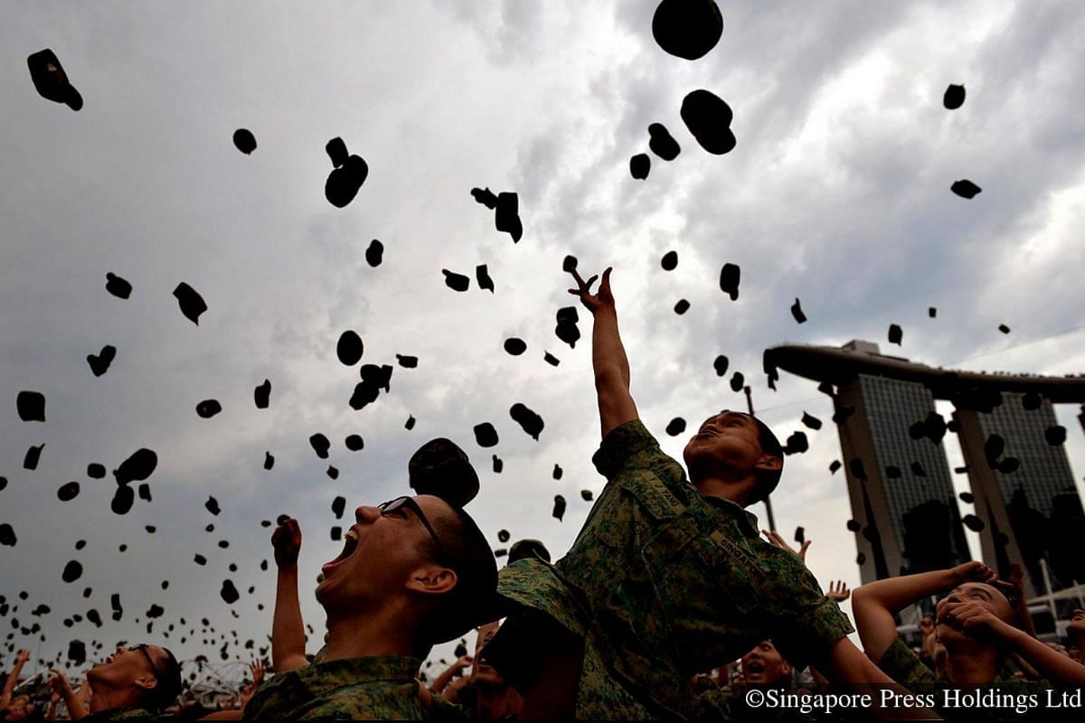 2014: Jubilant soldiers throwing their jockey caps in the air to celebrate the end of their basic military training.
