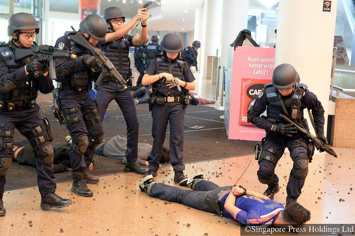 2016: Servicemen learn how to take down attackers in an anti-terror exercise, codenamed Exercise Heartbeat, by the Singapore Police Force and Singapore Civil Defence Force at the Esplanade on Sept 2, 2016.