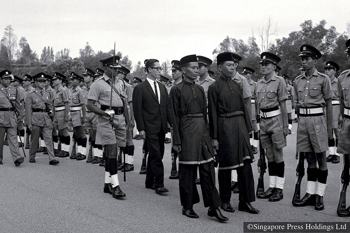 1968: Major Fong Sip Chee inspecting the guard of honour during the second passing out parade of Special Constabulary (National Servicemen), or SC(NS), at the Police Training School in Thomson Road. The school was officially elevated to an Academy th