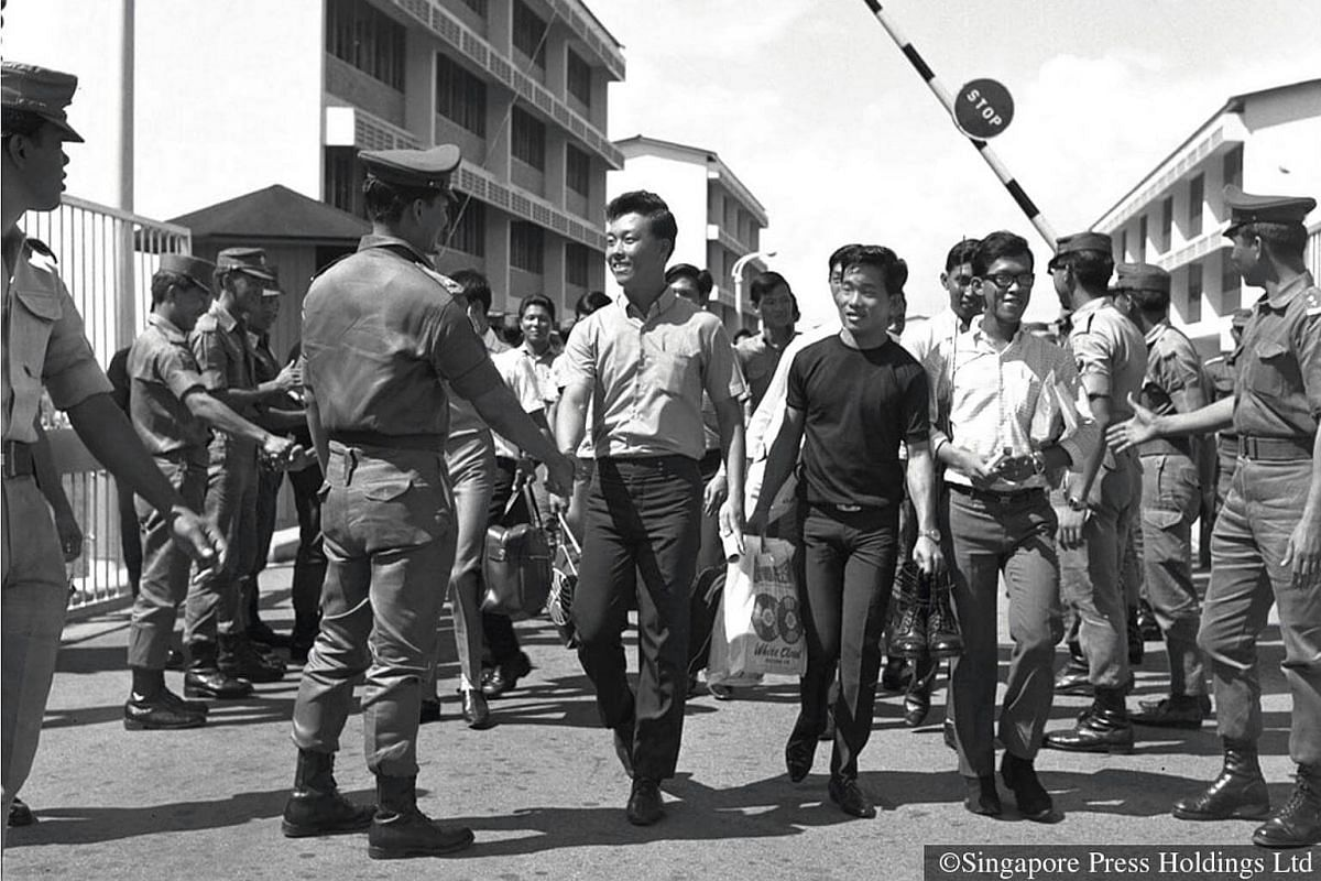 1969: 'Cheerio, Sir,' say the young national servicemen. 'Good luck,' reply their commanding officer. Singapore's 'first 1,000' NSmen trooping out of the Bedok camp and camps across the island as they return to civilian life.
