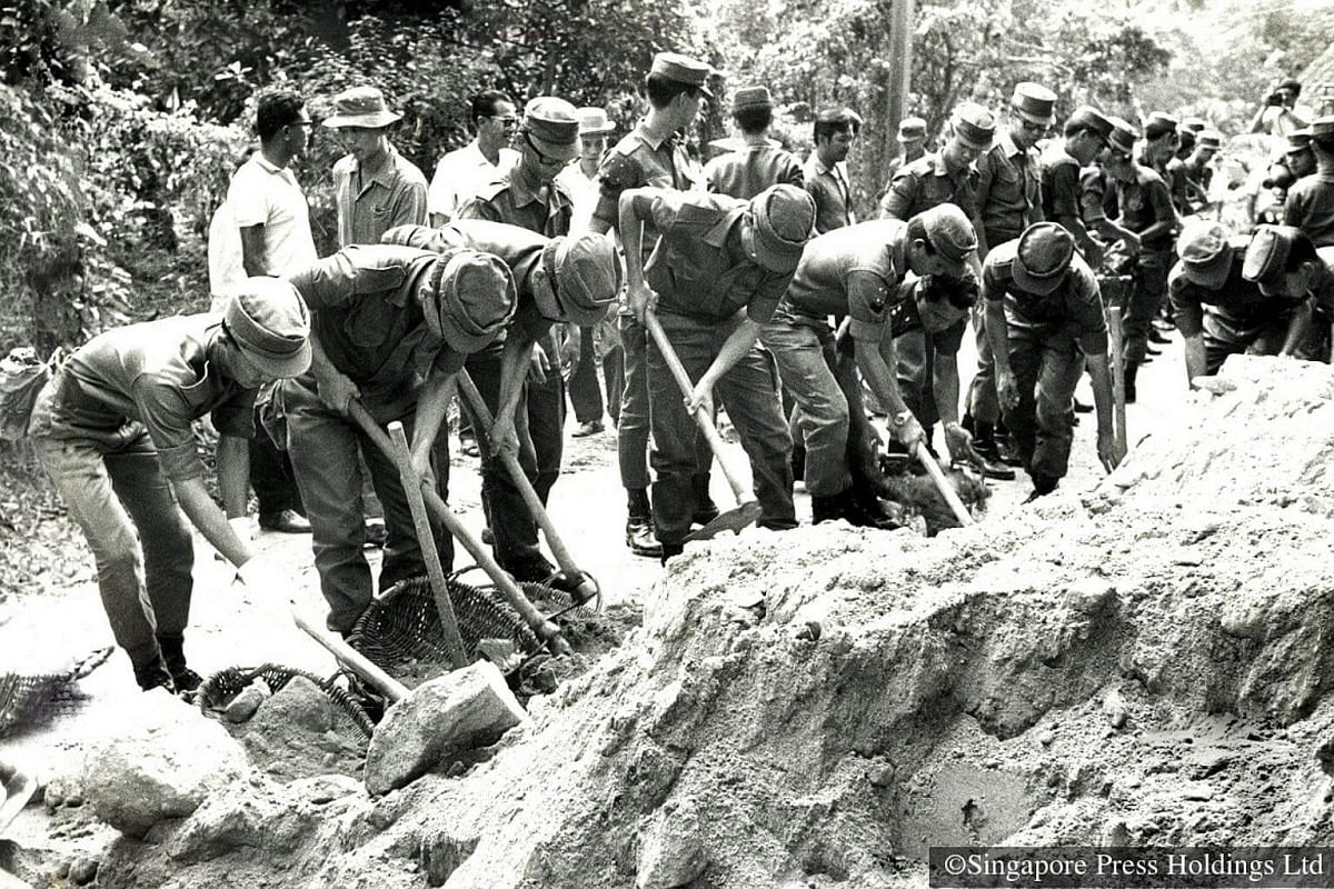 1971: NSmen carrying out 'gotong royong' (communal work) as they lend a hand in road repair works off Jurong.