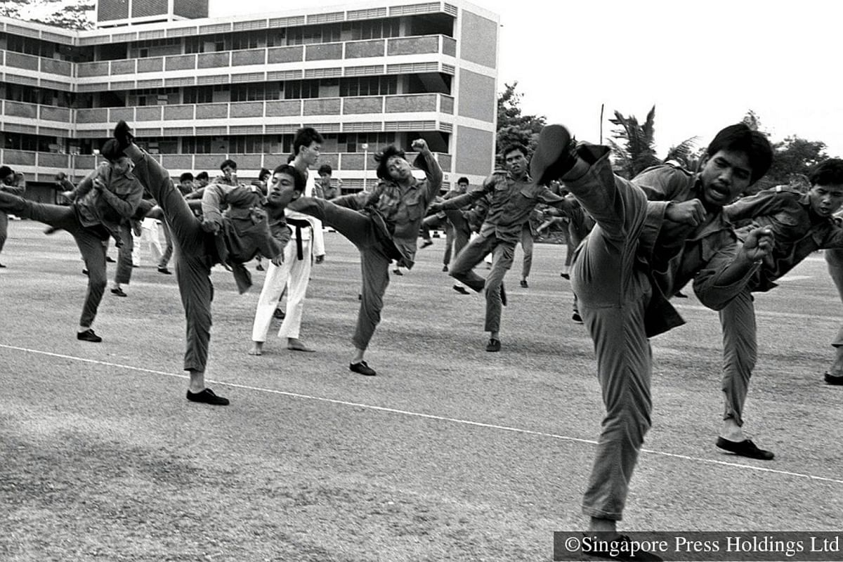 1983: Soldiers from the 3rd Battalion Singapore Guards practising taekwondo in camp. The 3rd Guards repeatedly topped the SAF units in areas such as marksmanship, physical fitness, field cooking, lowest vehicle accident rate and taekwondo.
