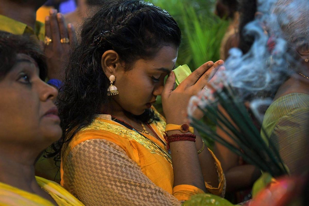 A devotee prays to Sri Murugan as the chariot arrives at the Sri Thendayuthapani Temple on the evening of Feb 8, 2017.  Thaipusam is a thanksgiving festival and it is a day for devotees to celebrate the fulfilment of their vows.