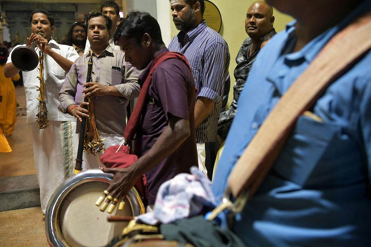 Temple musicians perform as the chariot carrying Sri Murugan arrives at the Sri Thendayuthapani Temple on the evening of Feb 8, 2017. The number of static music points have been increased from nine to 23 for Thaipusam 2017. There are also three live