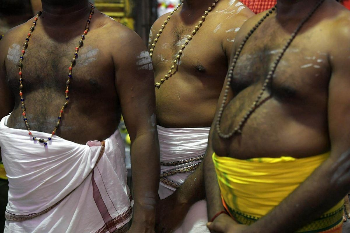 Members of the temple await the installation of Sri Murugan in the temple as the chariot carrying Sri Murugan arrives at the Sri Thendayuthapani Temple on the evening of Feb 8, 2017. Thaipusam is mainly observed in countries with large Tamil communit