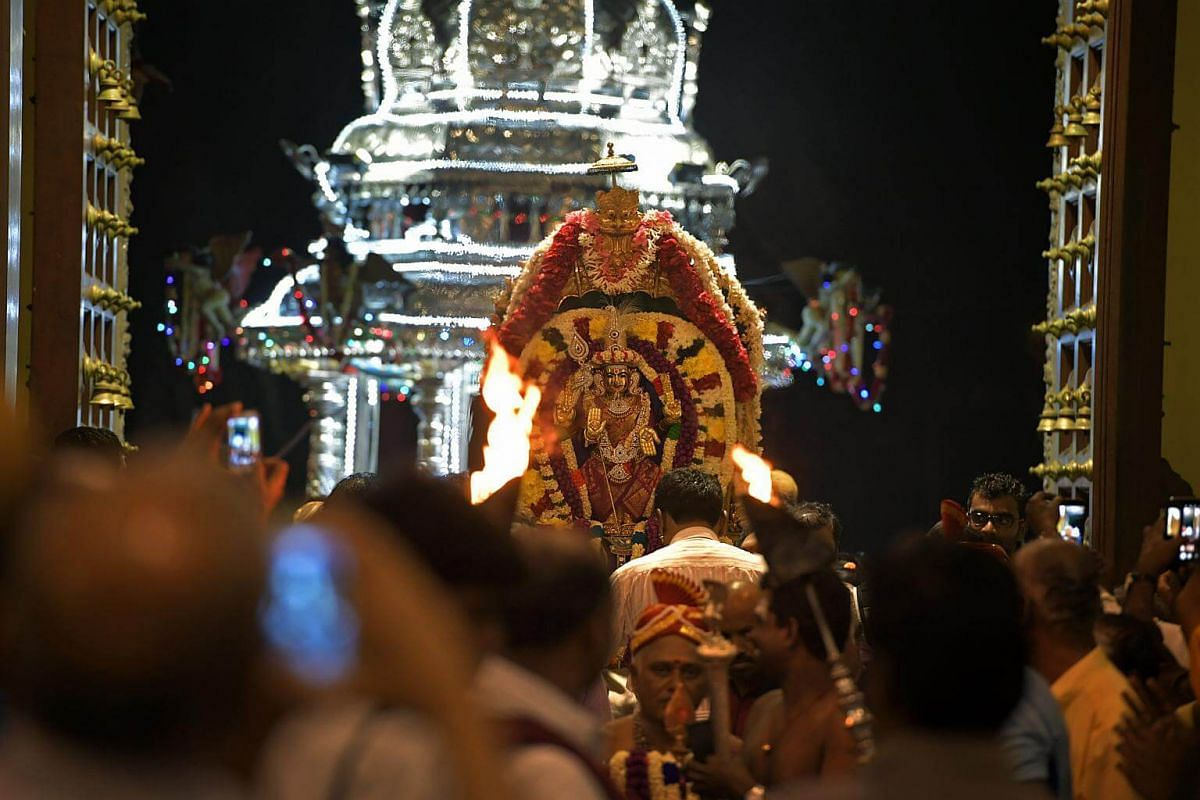 Sri Murugan is ceremonially carried from the chariot back to the Sri Thendayuthapani Temple on the evening of Feb 8, 2017.
